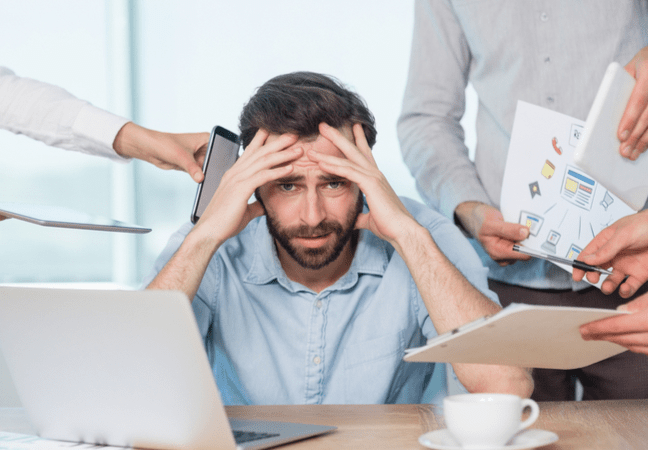 man overwhelmed with workload