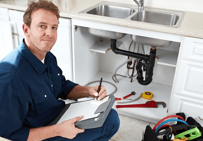 plumber working on kitchen sink
