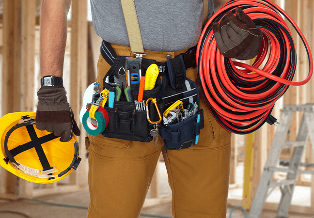 electrical contractor holding gear and equipment