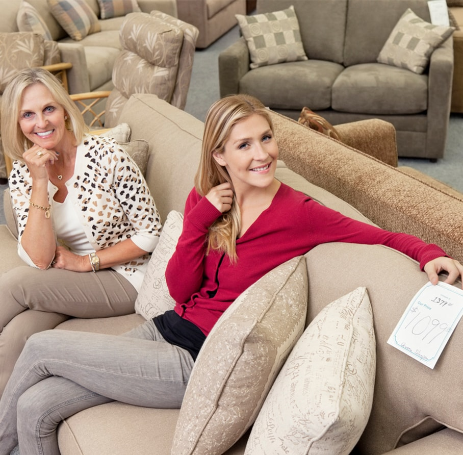 women sitting on couch in consignment furniture shop