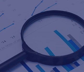 magnifying glass analyzing business financials