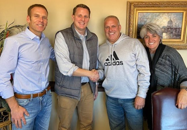 old owners of elite roofing meet with new owners
