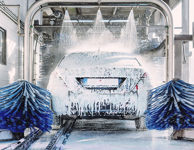 car covered in soap in car wash line