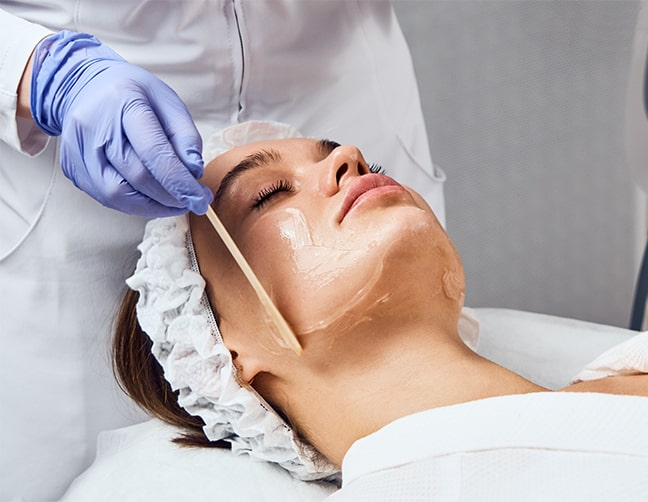 close up of woman receiving facial treatment at medical spa in charlotte, nc